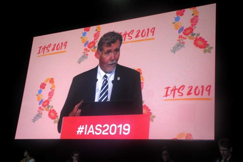 A large video screen displays Chris Beyrer, M.D., as he presents HPTN 078 study results at IAS 2019.