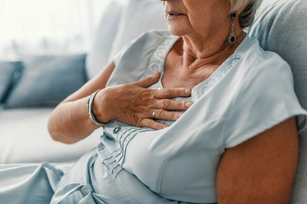 Senior woman having a pain in the heart area