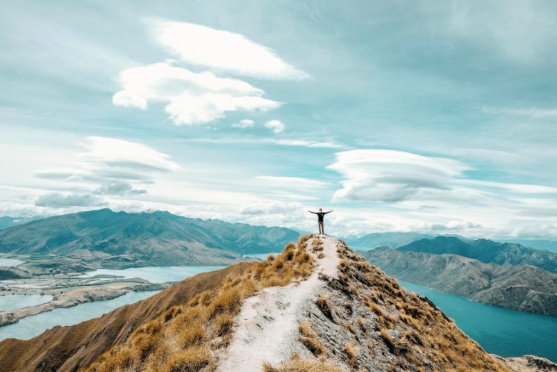 person standing at top of mountain in New Zealand