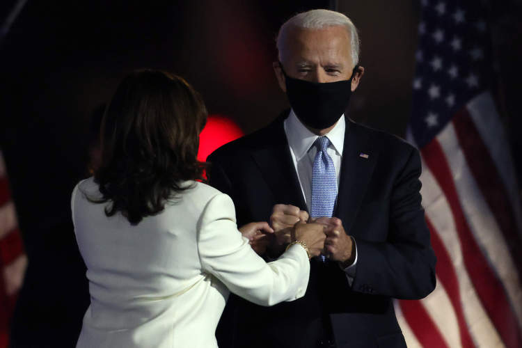 President-elect Joe Biden And Vice President-elect Kamala Harris fist bump after election win