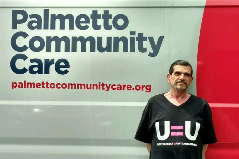 Michael Luciano in front of Palmetto Community Care van