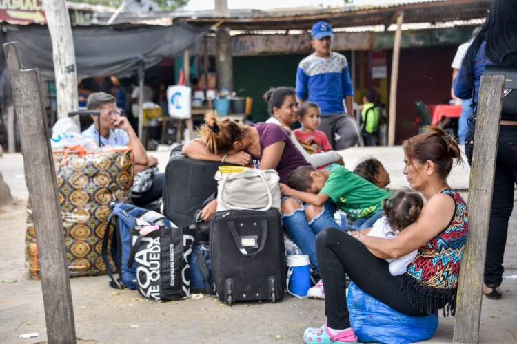 Venezuelans rest after crossing the border between Colombia and Venezuela on June 09, 2019 in Paraguachon, Colombia.