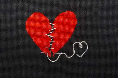broken heart with zig-zag thread holding it together embroidery