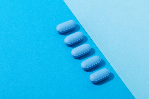 blue pills on blue background
