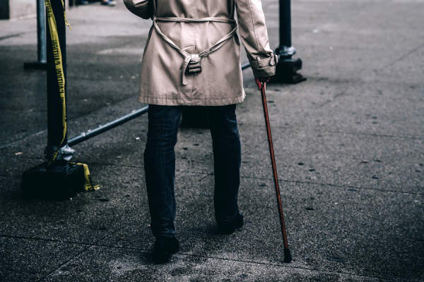 man walking with cane