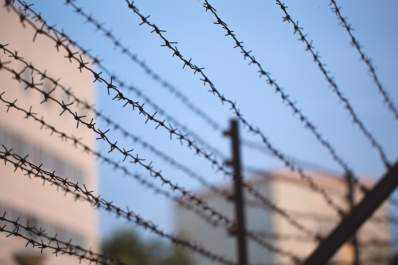 barbed wire in front of prison
