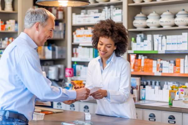 pharmacist helping senior customer