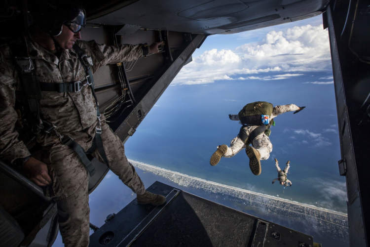 airmen jumping out of US Airforce plane