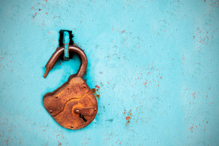 open padlock on blue background