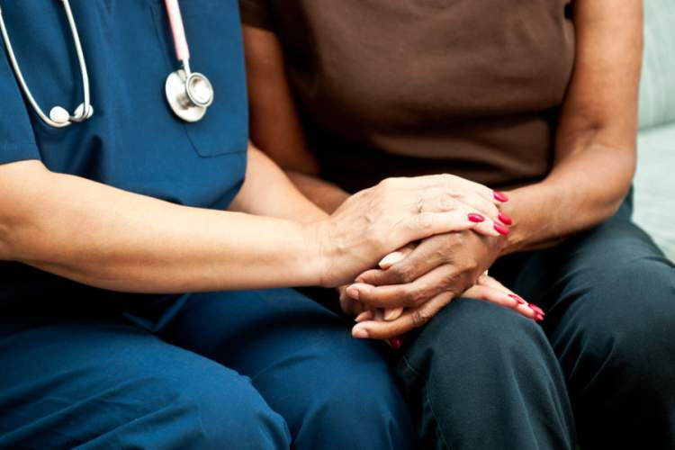 Healthcare Worker's Hands comforting patient