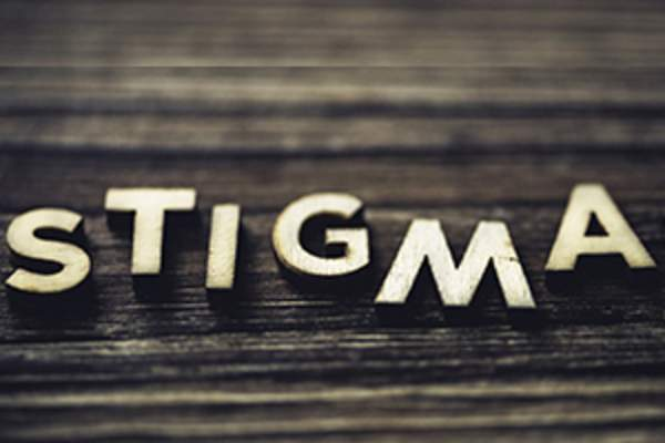 STIGMA in staggered wooden letters on wood background