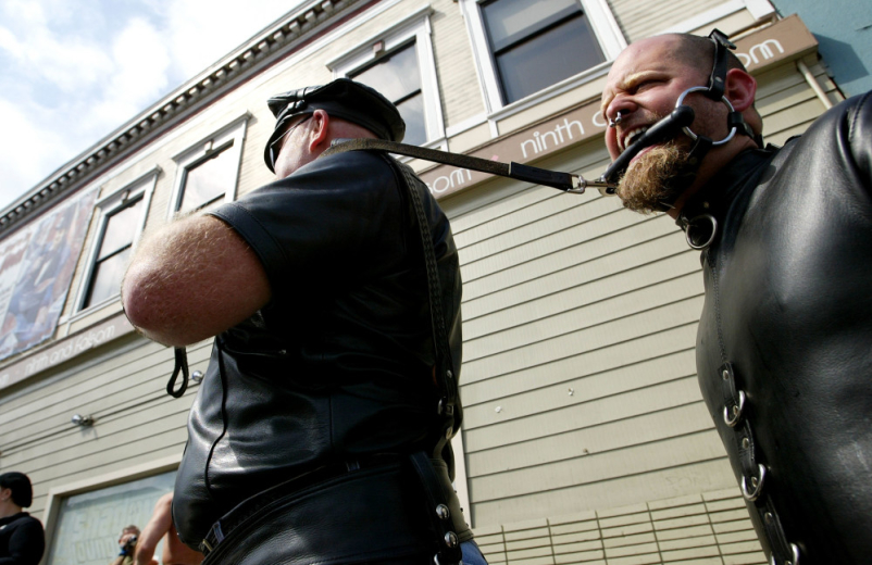 "A man pulls his ""slave"" at the 20th Annual Folsom Street Fair in San Francisco, California."