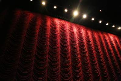 red curtain and lights in theater