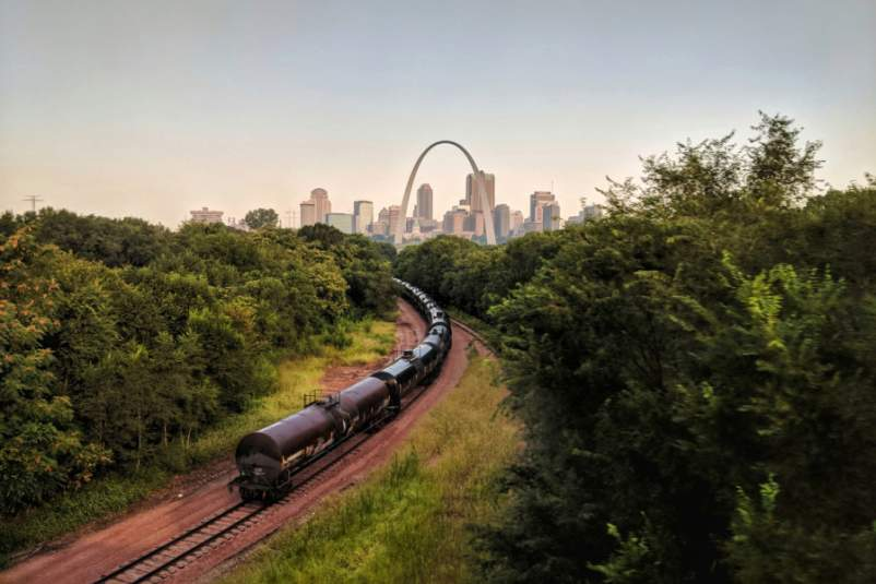 train traveling through Missouri, St. Louis skyline in background