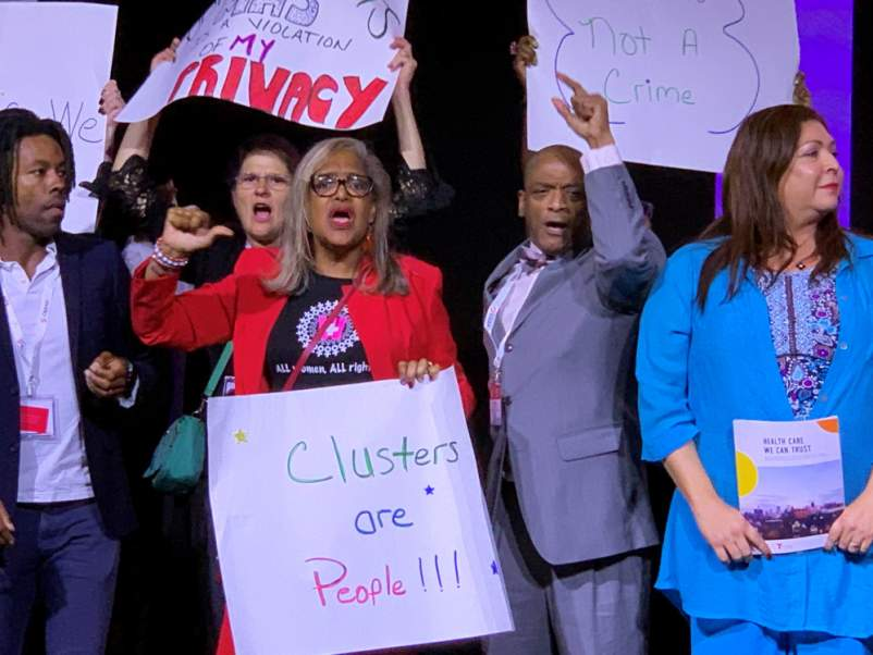 Jaron Benjamin, Lepena Reid, Bryan Jones, and Arianna Lint protest at the U.S. Conference on AIDS (USCA) opening plenary session on Sept. 5
