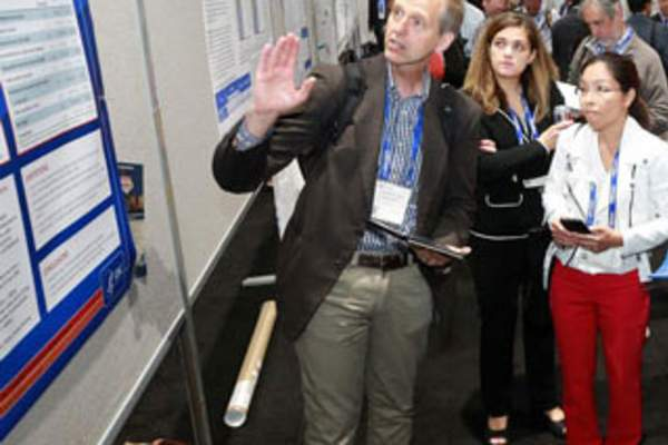 Attendees discuss a poster presentation at IDWeek 2017