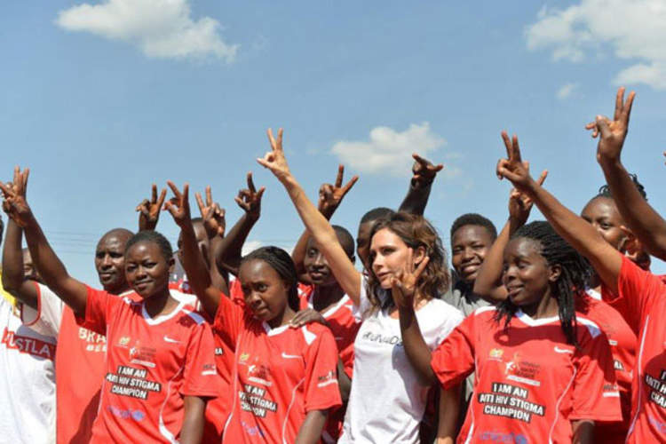 UNAIDS International Goodwill Ambassador Victoria Beckham with the girls team at the launch of the national football campaign Maisha Kick Out HIV Stigma, which aims to motivate young people to get tested for HIV