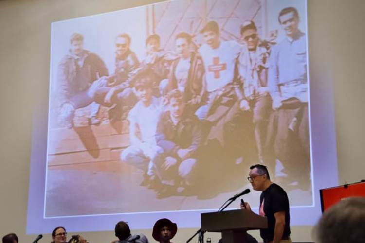 Fernando Marsical speaking at Hidden Histories; background photo of Latina/o Caucus members also by Fernando Mariscal (Credit: Molly Gingras)