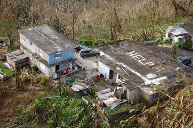 House in Puerto Rico with 'HELP' on written on roof
