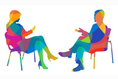 Silhouette of a woman and man sitting and talking