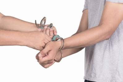 A man having his handcuffs removed