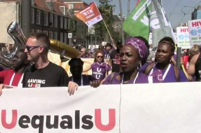 HIV activists march in Amsterdam on July 23 during the 2018 International AIDS Conference