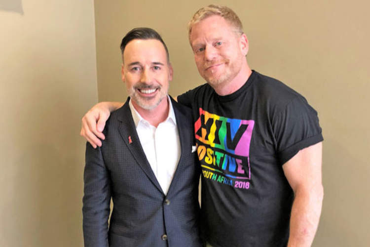 David Furnish (left) with Mark S. King at AIDS 2018 in Amsterdam, the Netherlands
