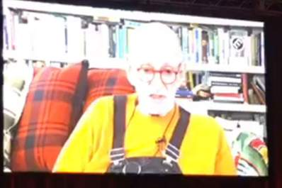 Larry Kramer addresses USCA 2018 attendees via video
