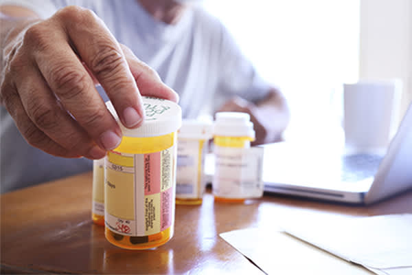 Man reaching for prescription medication