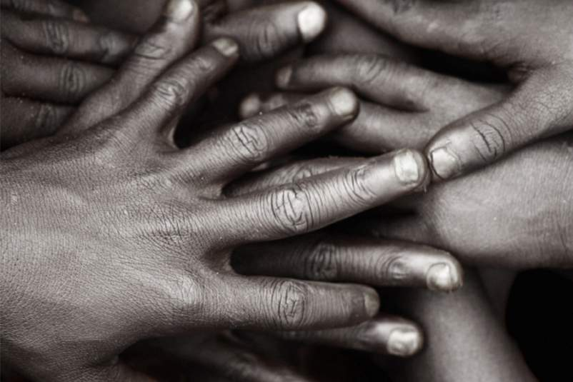 Hands piled on top of each other