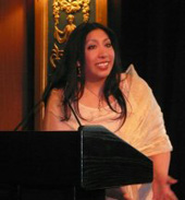 Gracia accepting the Keith Cyler AIDS Activist Award.