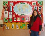 On World AIDS Day, Dec. 1, 2006, in front of a display on women and HIV at the Placerville, Calif. Public Health Department. Loreen and a colleague created the display to offer much-needed HIV education to both Spanish- and English-speaking women in the a