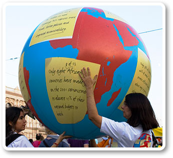 A globe is passed during the march for human rights.