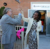 Charles King and Nadine Juste-Beckles 'high-five' at ribbon-cutting ceremony.