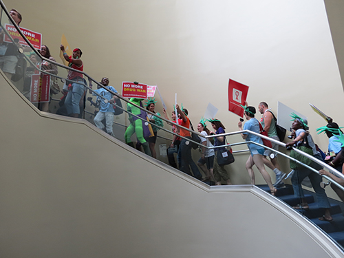 Activists ascend the stairs at the Walter Washington Convention Center to begin the march.