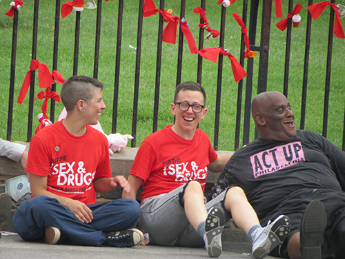 Julie Davids, center, director of national mobilization and advocacy for the AIDS Foundation of Chicago, shares a laugh with her fellow activists while waiting to be arrested.