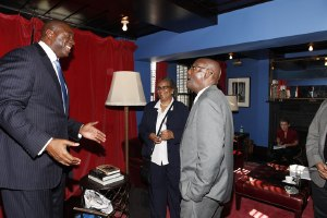 NAPWA's Steve Bailous (r) with Magic Johnson