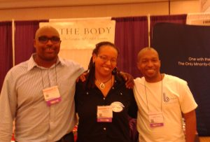 Jason and Reggie with Olivia, between their two companies' exhibit booths at the U.S. Conference on AIDS in 2012.