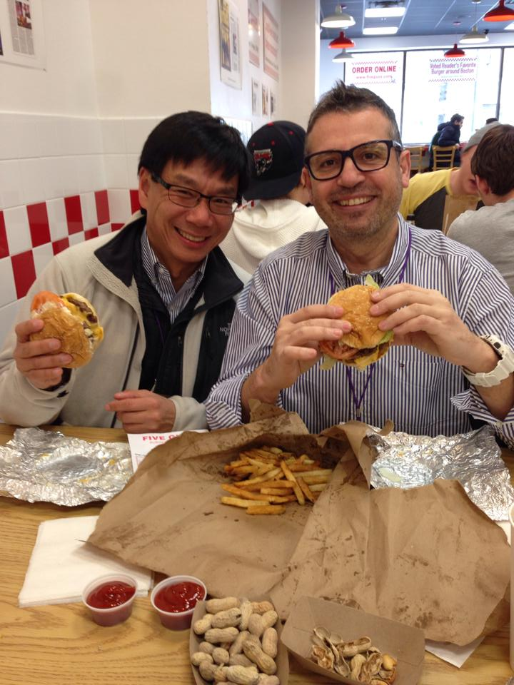 Benjamin Young (left) and Josep M. Llibre share a Five Guys burger lunch during CROI 2014