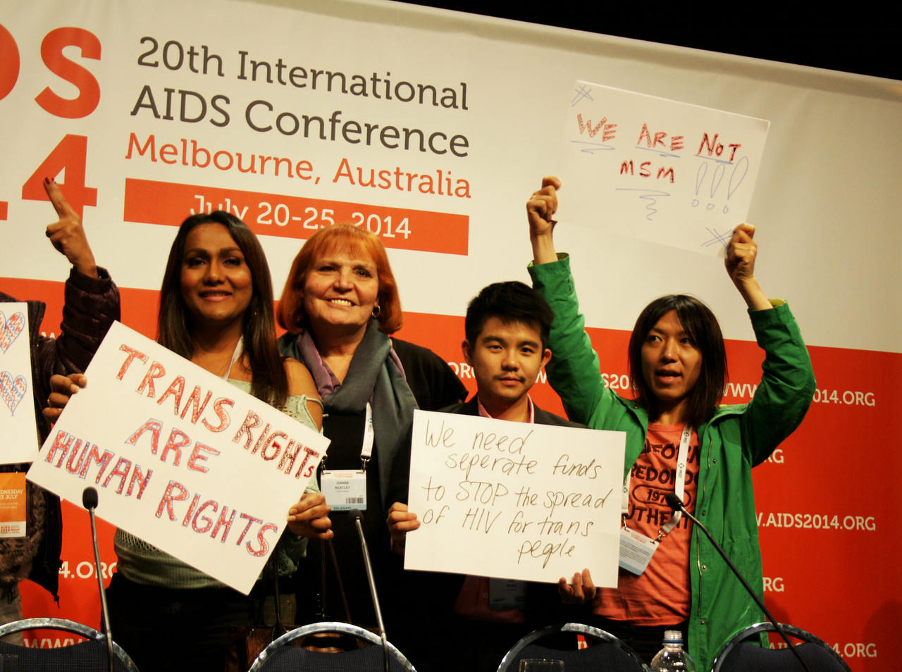 JoAnne Keatley, in center without sign. (Photo: International AIDS Society/Elisabetta Fino)