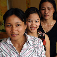 Members of the Sunflower Group, a group of 200 women who support and educate women about HIV/AIDS in Hanoi. Vietnam 2006. (Credit: Lorrie Graham/AusAID)