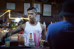 AltaMed is conducting HIV prevention outreach at several Latino gay bars in the Los Angeles area. Latinos make up about 21 percent of new infections nationally, according to the U.S. Centers for Disease Control and Prevention. (Credit: Heidi de Marco/KHN)