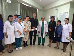 Dr. Lo (third from right) visits a community-based viral hepatitis treatment facility in Ulaanbaatar, Mongolia.