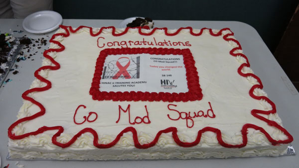 A cake at HIV is Not a Crime II to celebrates the Colorado Mod Squad's legislative victory (Credit: Victoria Law)