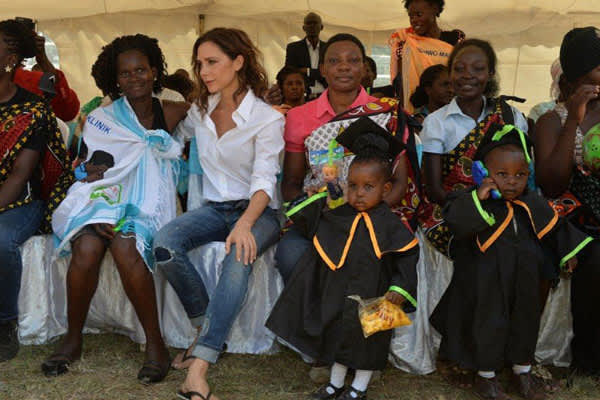 UNAIDS International Goodwill Ambassador Victoria Beckham celebrates with the mothers and their children at the HIV-exposed infant graduation ceremony