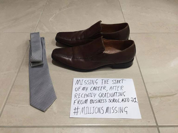 Empty shoes and sign saying 'Missing the start of my career, after recently graduating from business school #MillionsMising'