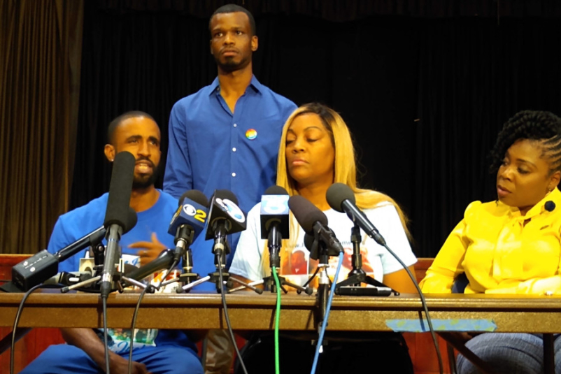 Left to right: friends of Gemmel Moore Cory McLean and Jerome Kitchen, mother of Gemmel LaTisha Nixon, activist Jasmyne Cannick.