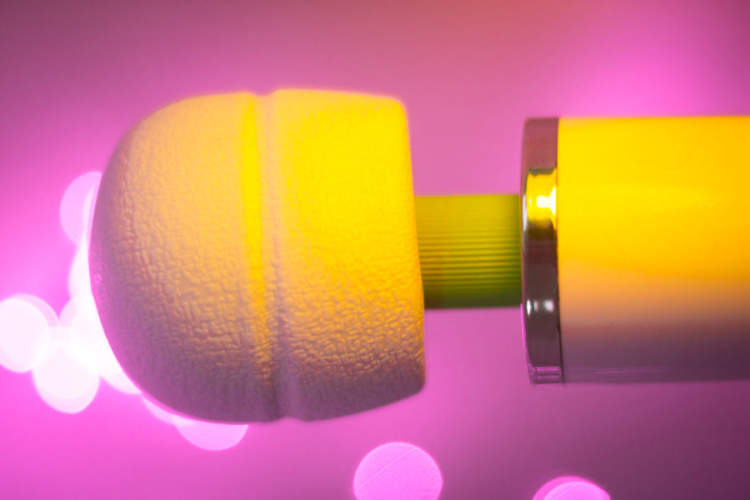 vibrator with yellow lighting, pink background