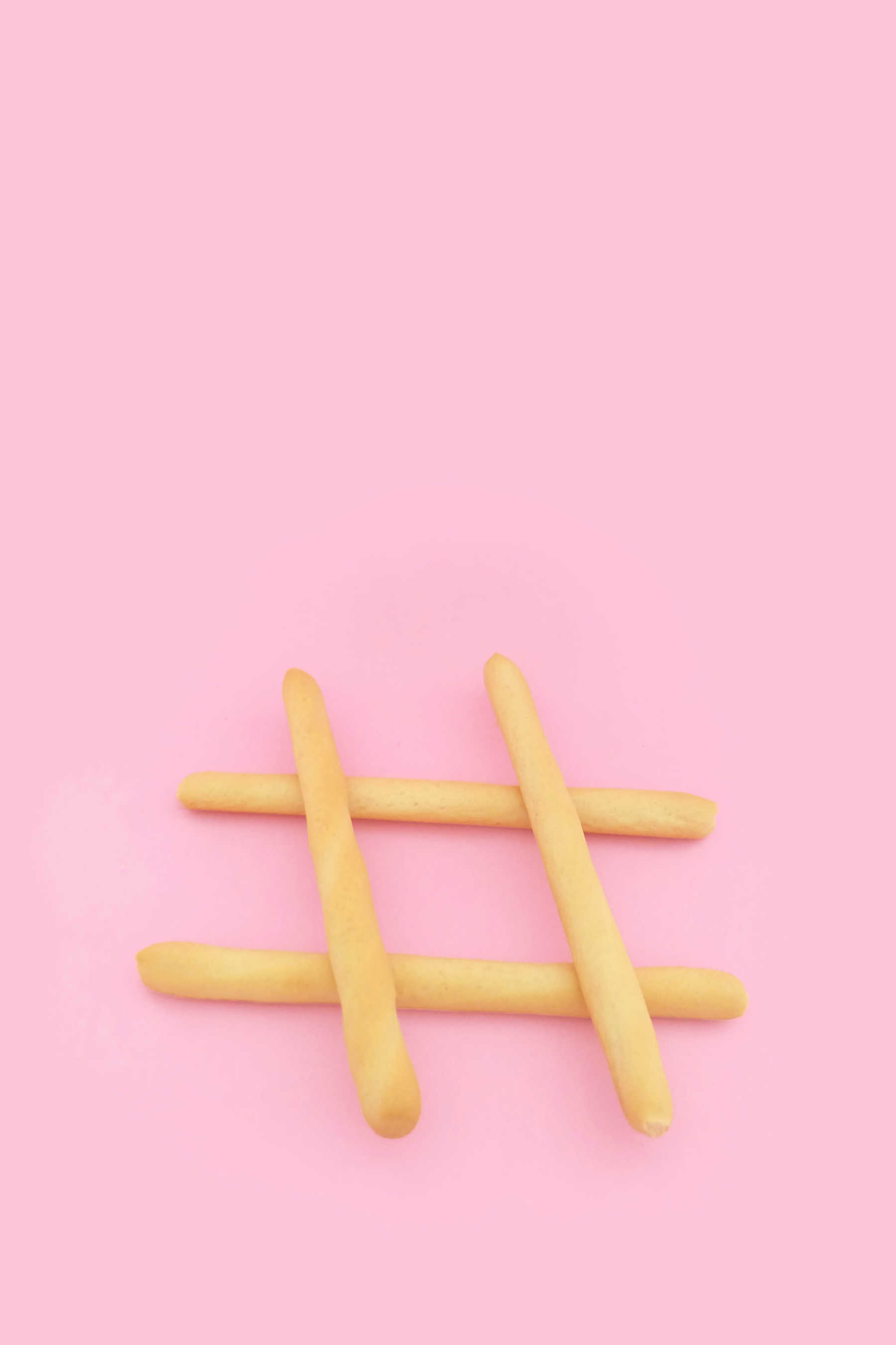 Digital marketing hashtag symbol on pink background