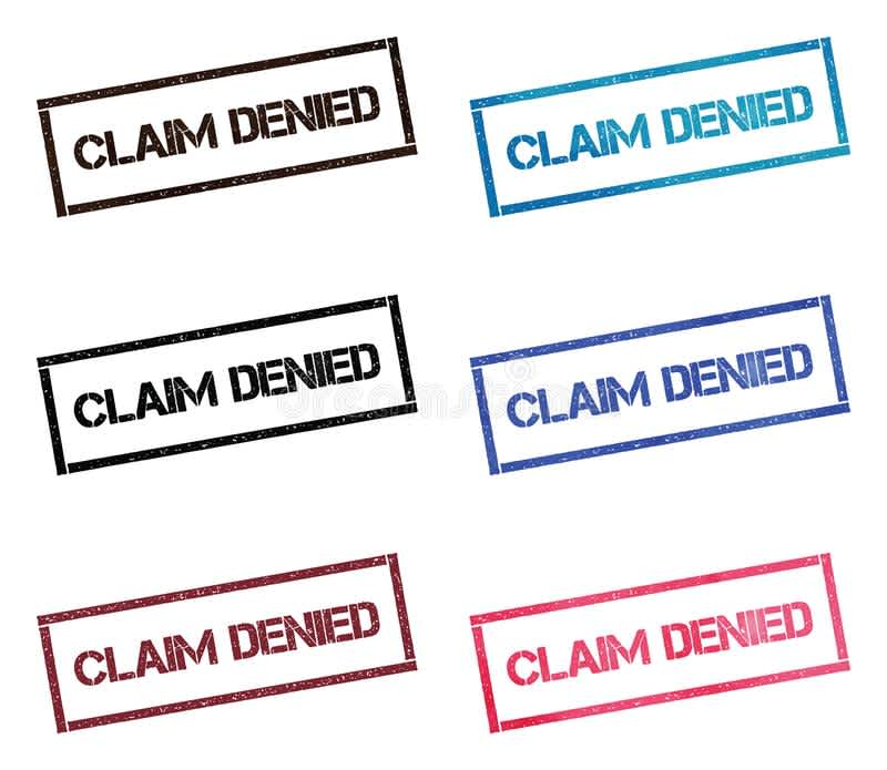 "this is a photo of a stamp stating ""claim denied."" There are six of them. And they are in five colors. Black, green, blue, pink, and maroon."